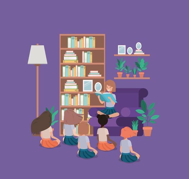 Alunos sentados no livro de leitura da sala de visitas