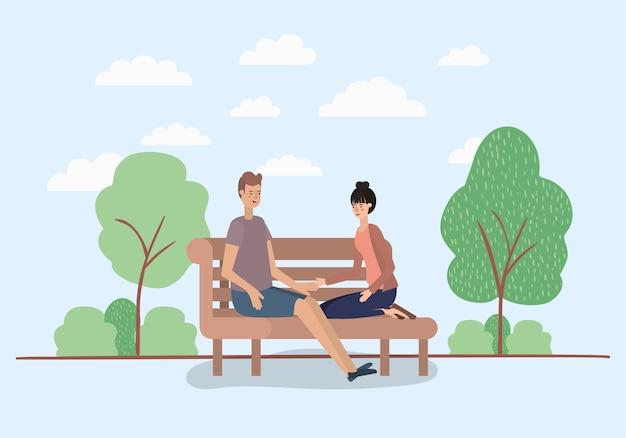 Amantes do jovem casal sentado na cadeira do parque