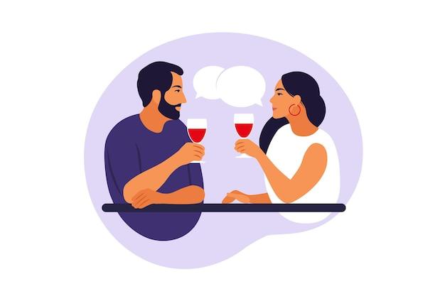 Amigável ou amor conhecer o conceito de mulher e homem. casal alegre sentado à mesa, conversando, rindo, bebendo vinho.