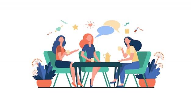 Amigos do sexo feminino saindo no café