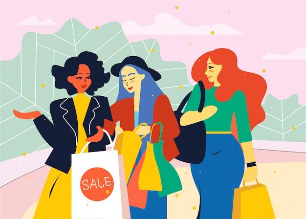 Amigos do sexo feminino vão da loja com sacolas de compras.