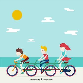 Amigos em uma bicicleta com fundo paisagem da praia Vetor grátis