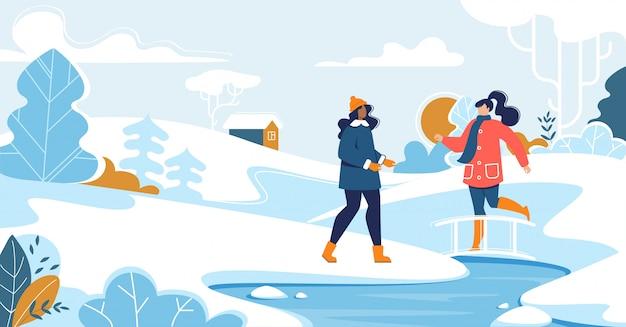 Amigos reunidos em caminhada no parque natural de neve