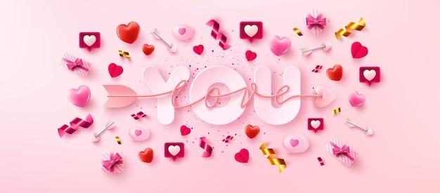 Amo você cartão ou banner com o símbolo do script de amor de seta sobre a palavra e os elementos dos namorados no fundo rosa.