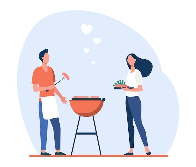 Amoroso homem e mulher fazendo churrasco de quintal.