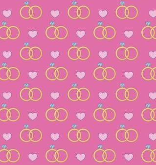 Anéis de noivado e fundo de corações