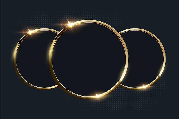 Anéis dourados brilhantes com copyspace em fundo escuro.