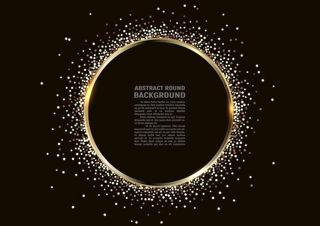 Anel dourado cintilante com glitter dourado isolado no fundo preto.