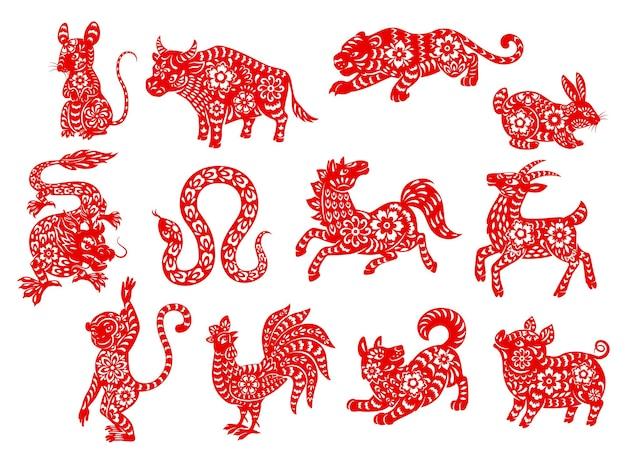 Animais do horóscopo do zodíaco chinês cortados em papel vermelho