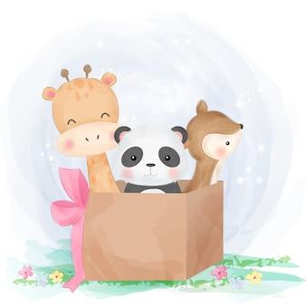 Animais fofos brincando com caixa