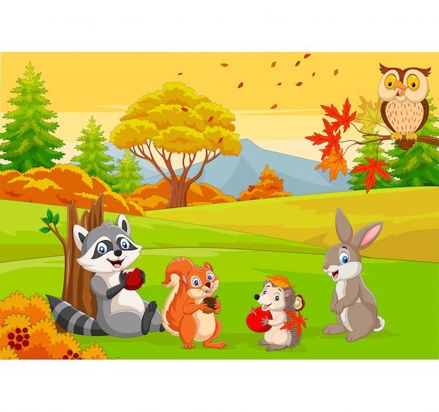 Animais selvagens dos desenhos animados na floresta de outono