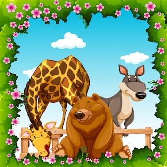 Animais selvagens em quadro de flor