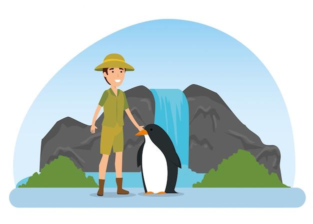 Animal selvagem de pinguim com homem de safari