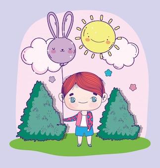 Anime menino bonito com coelho em forma de balão ao ar livre