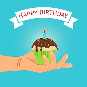Aniversário de cupcake de exploração de mão