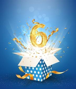 Aniversário de seis anos e caixa de presente aberta com confetes de explosões. celebração de aniversário de modelo seis em fundo azul