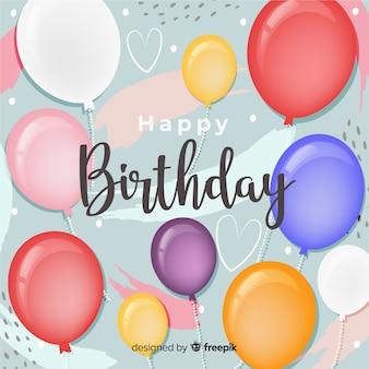 Aniversário desenhado de mão com fundo de balões