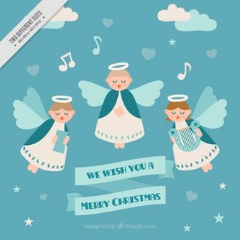 Anjos bonitos que cantam um fundo carol