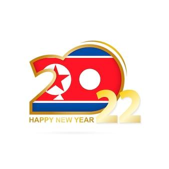 Ano de 2022 com padrão de bandeira da coreia do norte. feliz ano novo design.