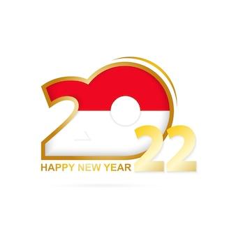 Ano de 2022 com padrão de bandeira da indonésia. feliz ano novo design.