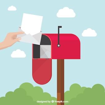 Antecedentes da pessoa pegando carta de caixa de correio