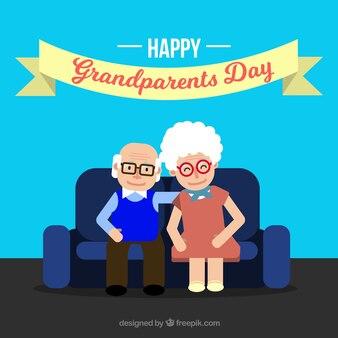 Antecedentes de avós sentados no sofá