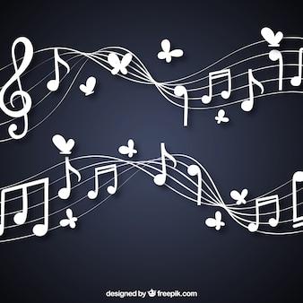 Antecedentes de pentagramas com notas musicais e borboletas
