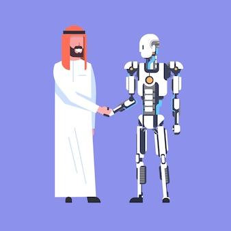 Aperto de mão do homem e do robô, homem de negócios árabe que agita as mãos com robótico moderno, conceito da inteligência artificial