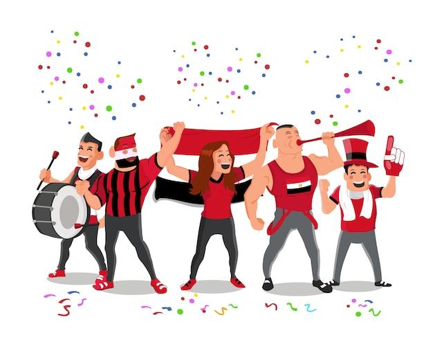 Apoiadores alegres da equipa nacional do futebol de egipto