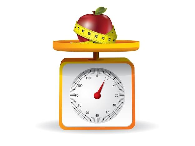 Apple na balança de comida de cozinha em fundo branco
