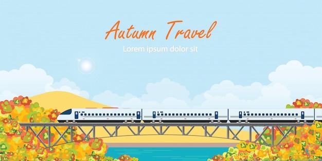 Apresse o trem na ponte railway em árvores coloridas do outono.