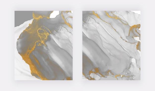 Aquarela de tinta álcool cinza com textura de glitter dourado