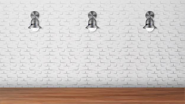 Arandelas de design preto na parede de tijolo branco