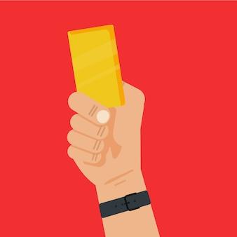 Árbitro de futebol de mão segurando um cartão amarelo