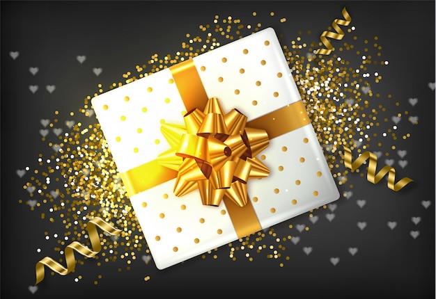 Arco dourado de caixa de presente