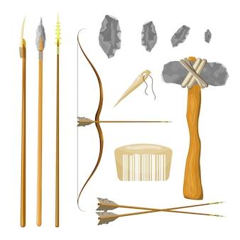 Arco e flecha, lança, martelo, pente, agulha, pedra isolado no fundo branco.