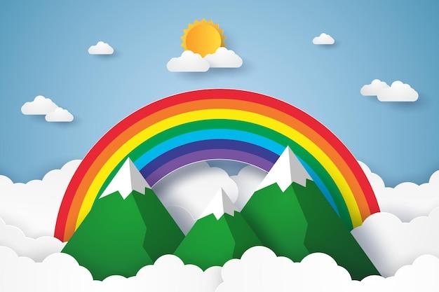Arco-íris e montanhas no céu azul com nuvens no estilo paper art
