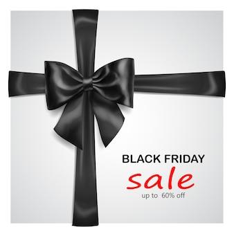 Arco preto com fitas transversais com sombra e inscrição venda de sexta-feira negra em fundo cinza