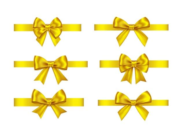 Arcos de presente dourado ajustados isolados no fundo branco. natal, ano novo, decoração de aniversário de ouro. elemento de decoração realista de vetor para banner, cartão, cartaz.