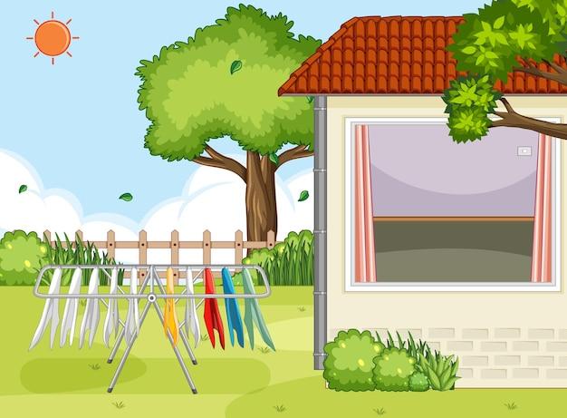 Área externa da casa com cabide de roupas