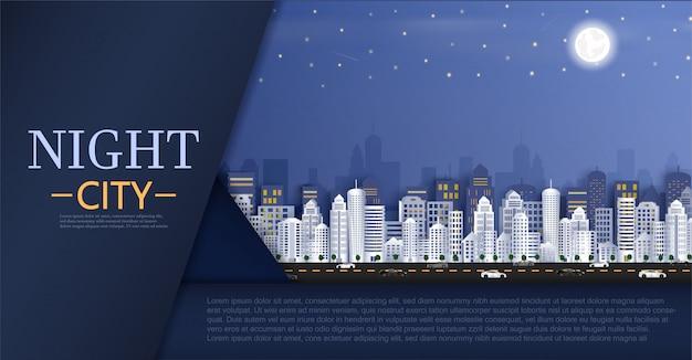 Arquitectura da cidade com grupo de arranha-céus na noite.
