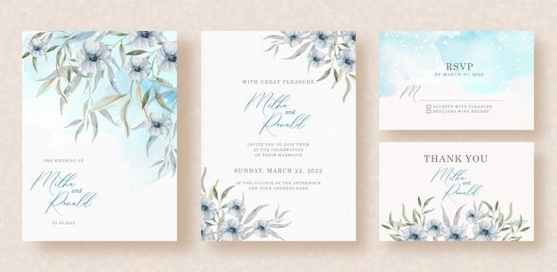Arranjo de flores roxas em aquarela com respingos de azul no fundo do convite de casamento