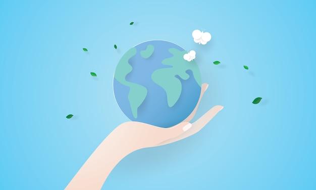 Arte de papel da bela mão segurando a terra, dia da terra, conceito de ambiente