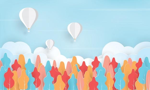 Arte de papel de balão de ar quente voando acima da floresta, férias