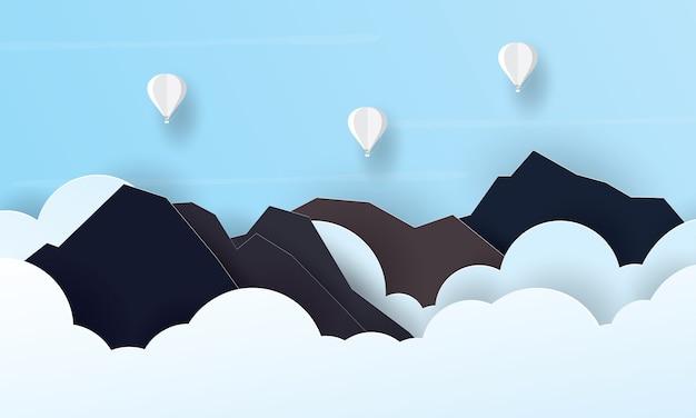 Arte de papel de balão de ar quente voando acima da montanha, conceito de férias