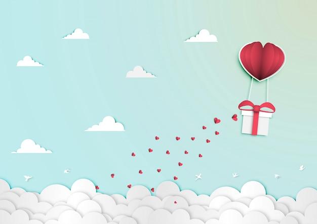 Arte de papel do festival de dia dos namorados com caixa de presente no vetor de forma de coração de balão de papel