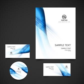 Artigos de papelaria do negócio com onda azul