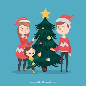 Árvore de decoração da família do natal bonito com chapéu de papai noel