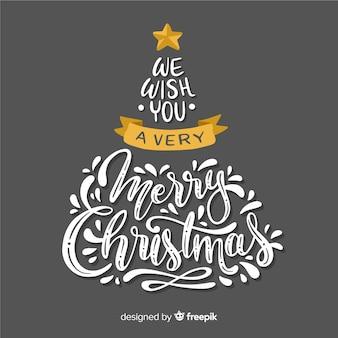 Árvore de natal com letras de feliz natal