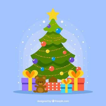 Árvore de natal decorada com presentes embaixo